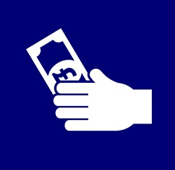 Hand holding British Pound banknote against blue background