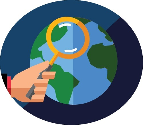 Person holding magnifying glass in front of globe