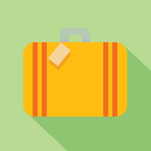 Yellow suitcase on green background