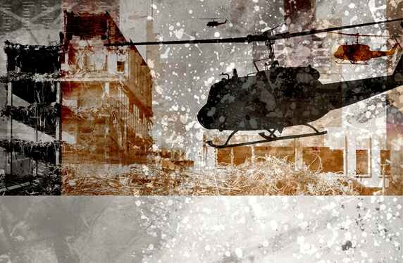 Silhouette of helicopter against ruined buildings