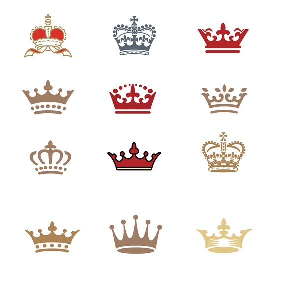 Assorted crowns on white background