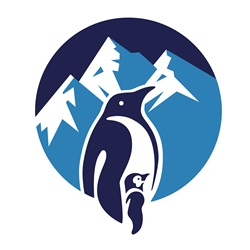 Penguin with chick with mountains in background