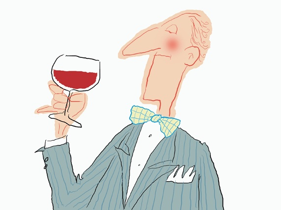 Man in suit with wine glass on white background