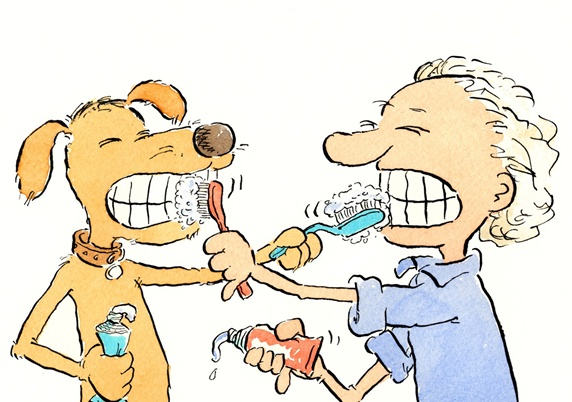 Boy and dog brushing each other teeth