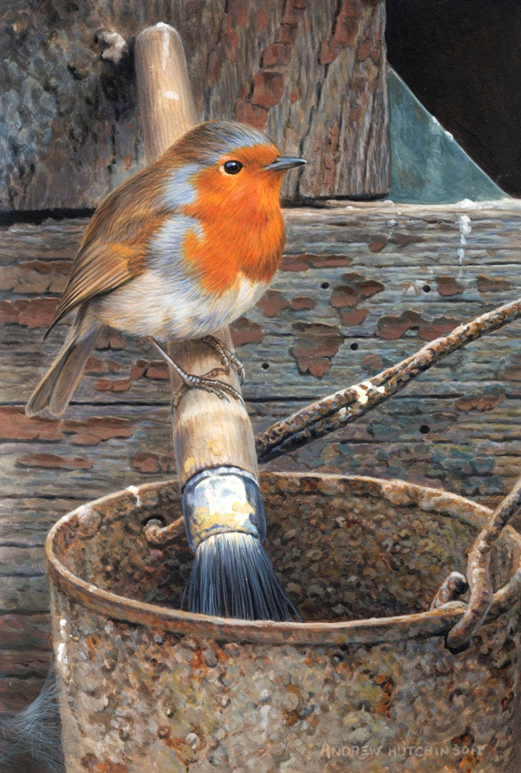 Robin perching on painting brush, weather wood in background