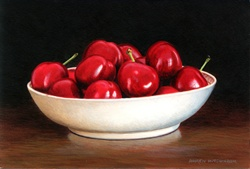 Red cherries in white porcelain bowl