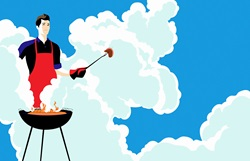 Young man barbecuing in clouds of smoke