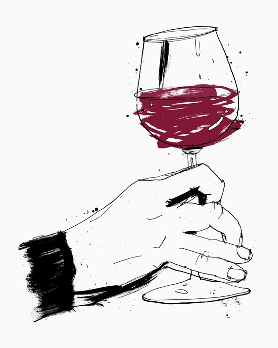 Hand swirling glass of red wine