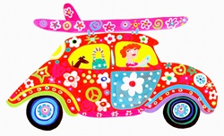 Woman driving hippy flower power car with surfboard on roof rack