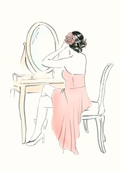 Woman sitting by mirror