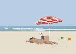 Woman sunbathing on sandy beach