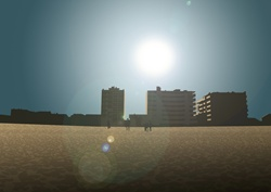 Field and residential blocks, sun flare