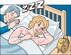 Woman with insomnia beside sleeping, snoring partner