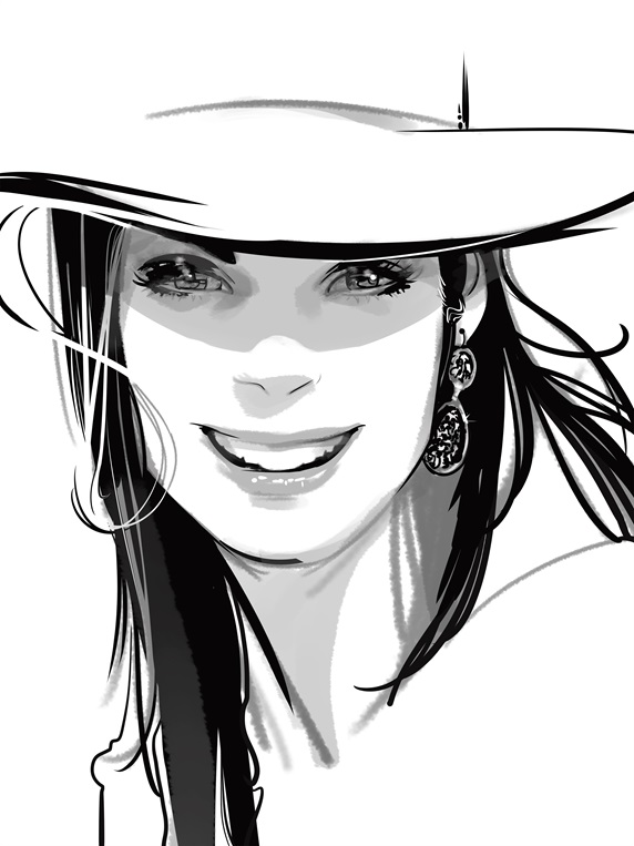 Portrait of young woman wearing hat and smiling