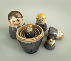 Frustrated businesswoman inside of open nesting dolls surrounded by smiling businessmen