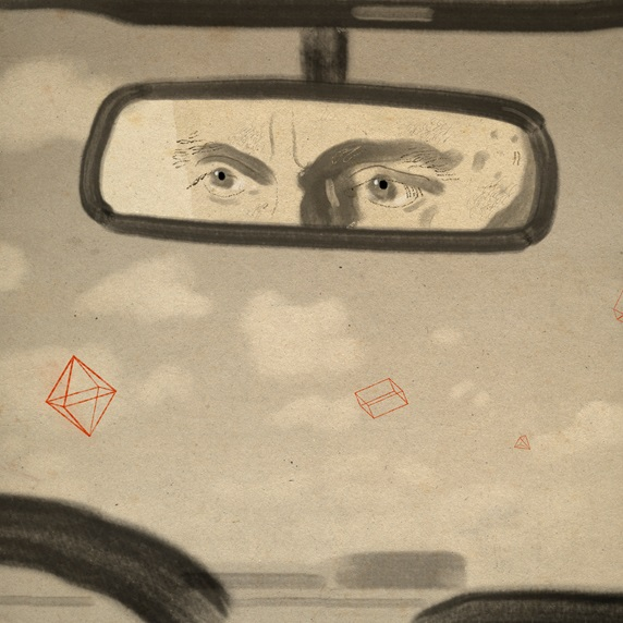 Man's eyes reflected in car rear view mirror