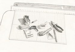 Assorted tools and paper