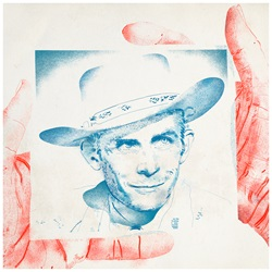 Hands holding portrait of Hank Williams