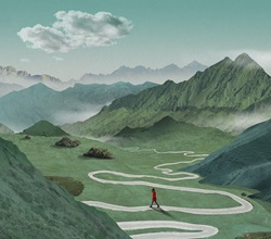 Woman in red coat walking on winding road in valley surrounded with green mountains
