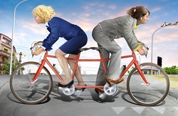 Businesswomen cycling in different directions