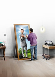 Young man seeing his future as businessman in mirror
