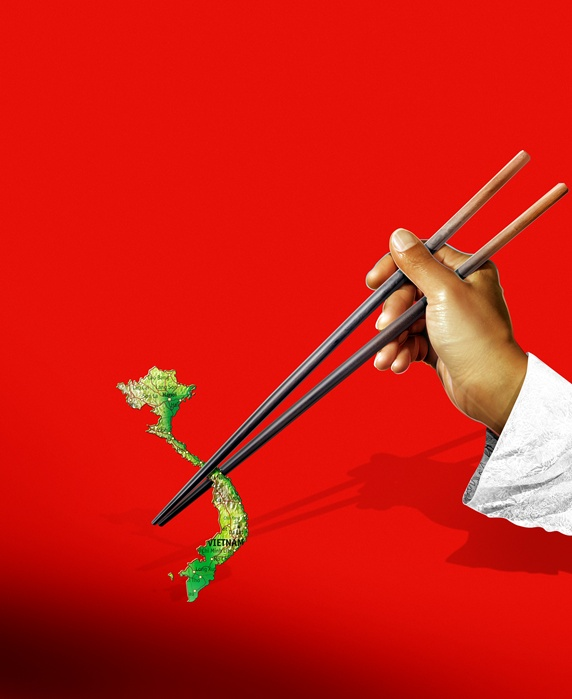 Man holding map of Vietnam in chopsticks