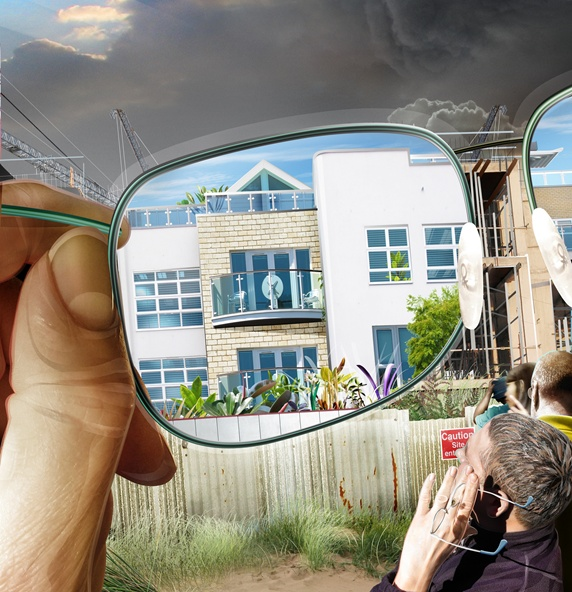 Man looking at building on construction site through spectacles