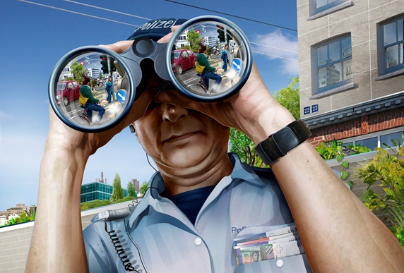 Police officer looking through binoculars