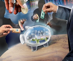 Business people investing money in transparent piggy bank containing renewable energy