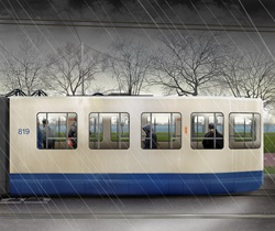 Passengers travelling in tram on rainy day