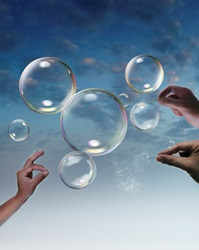 Hands bursting bubbles