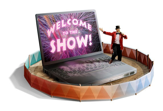 Male host next to laptop with welcome to show on screen in circus