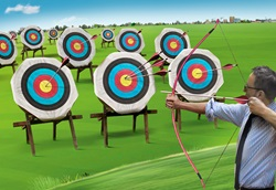 Businessman hitting lots of targets