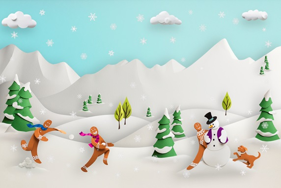 Paper sculpture of cute gingerbread men playing in snowy landscape