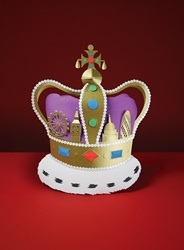 Paper crown on red background