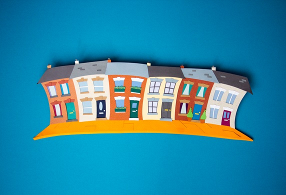 Paper houses on blue background
