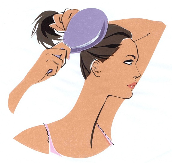 Young woman combing and making ponytail