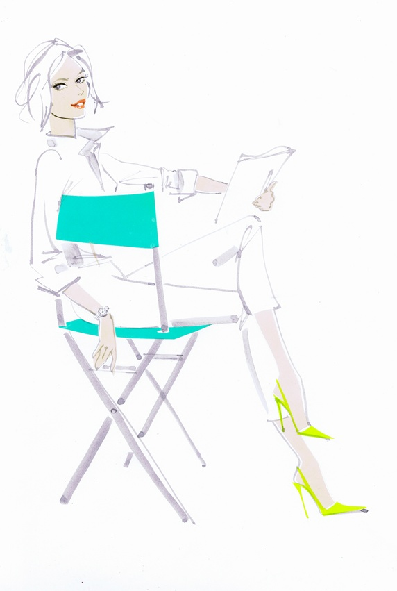 Elegant woman reading script in director's chair