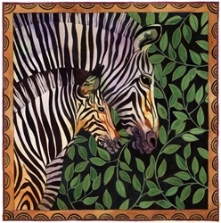 Two zebras against leaves