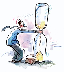 Businessman shaking hourglass