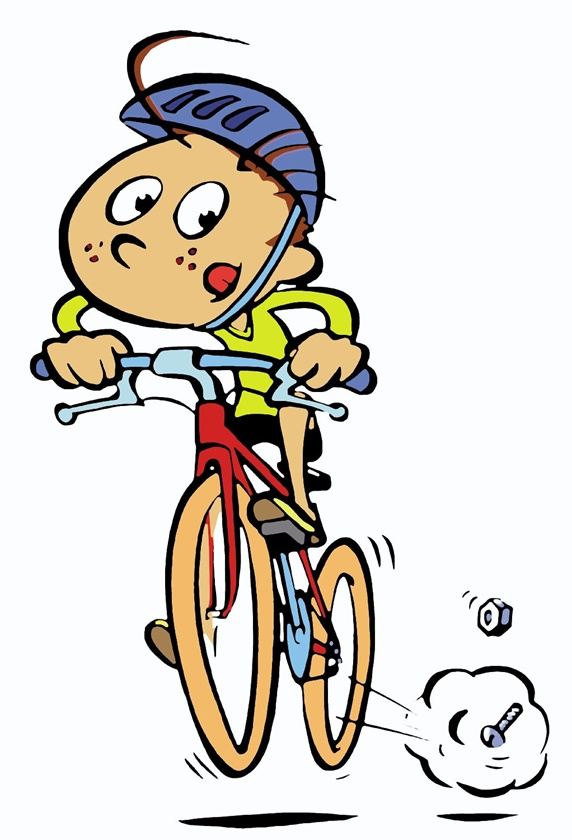 Boy sticking out tongue while cycling