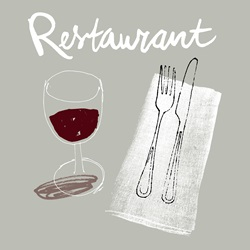 Red wine and cutlery in restaurant