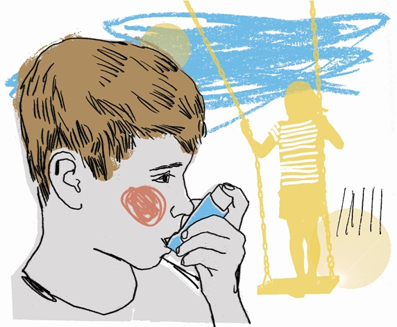 Boy using asthma inhaler in playground