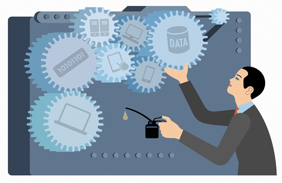 Businessman oiling the cogs of computer data connections