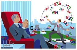 Businessman juggling with colorful numbers on manager's desk