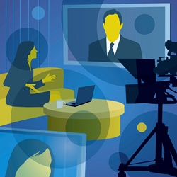 Woman interviewing man on visual screen in television studio