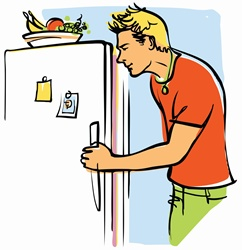 Young man looking into fridge