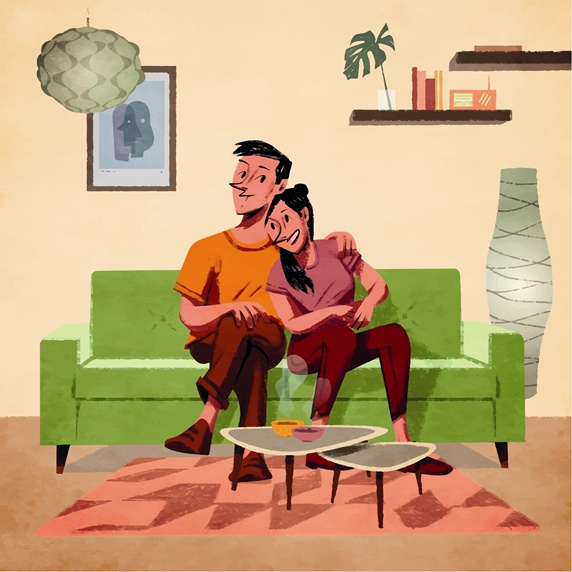 Young couple sitting on sofa in living room