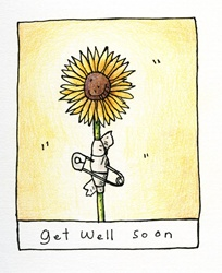 Sunflower in bandage and safety pin
