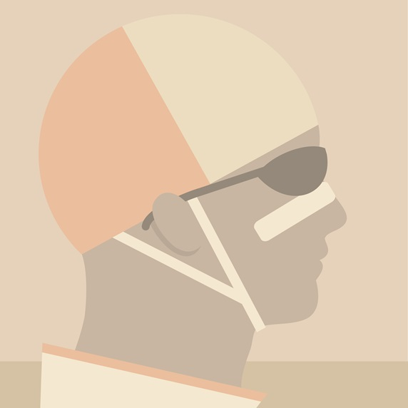 Profile of man wearing protective helmet and sunglasses